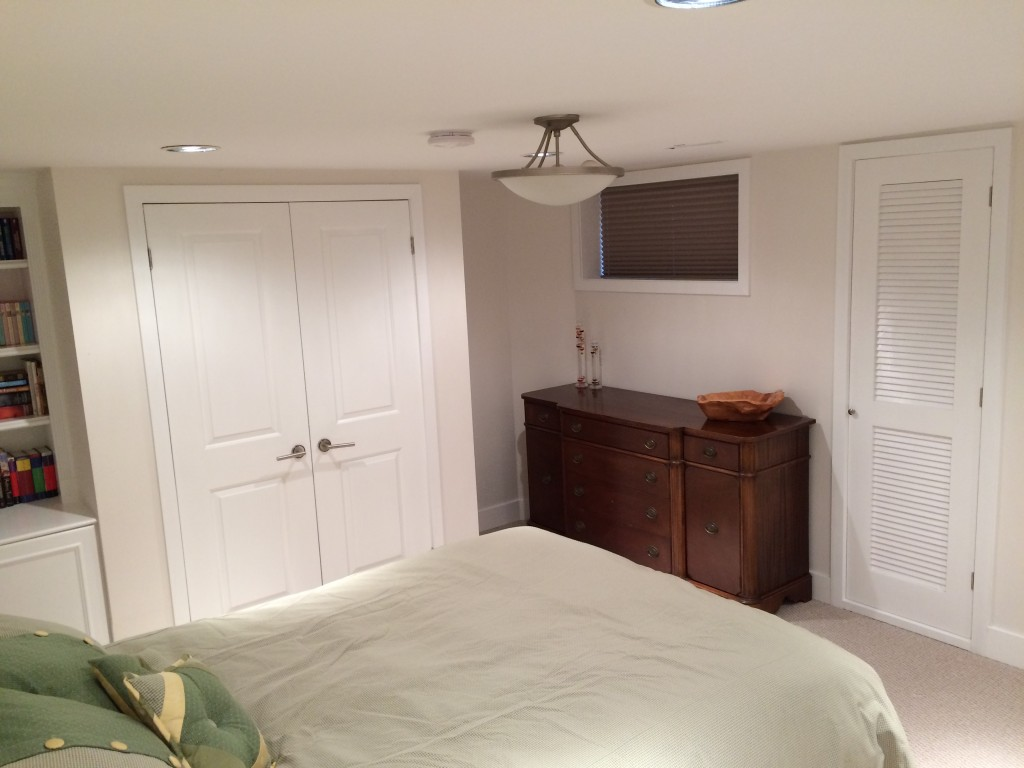 Basement room, new doors, trim around windows and doors, baseboards