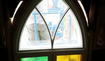 inside view of restored church window during installation process