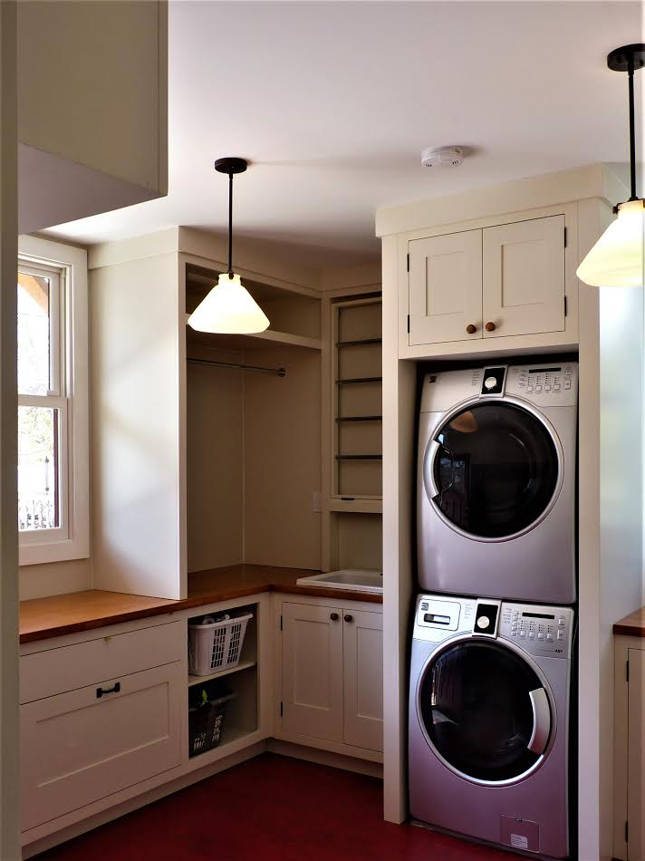 Mudroom detail: Pull-out recycling drawer, pull-down drying rack, sink, hanging space, laundry basket storage